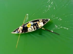 People fishing in flat water using kayak